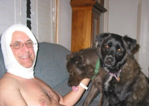 Kali and Bella aren't sure what to make of the compression bandage the ER doctor put on my neck.