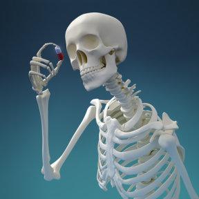 skeleton examining a pill